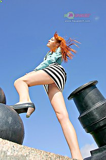 Foxy redhead with naked upskirt