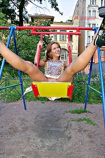 Naked upskirt of Anna on swings