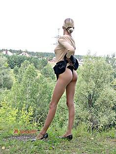 Skinny blonde Elvira upskirting outdoors
