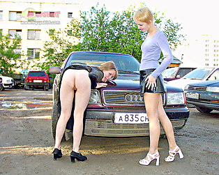 Threesome upskirt fuck on parking lot