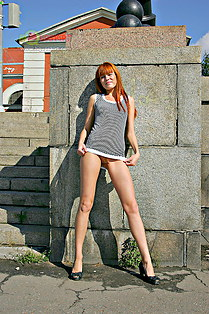 Candid up skirt of redhead model