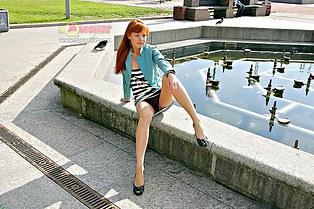 Redhead with panties upskirt