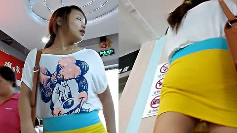 Upskirt voyeur filmed in a mall