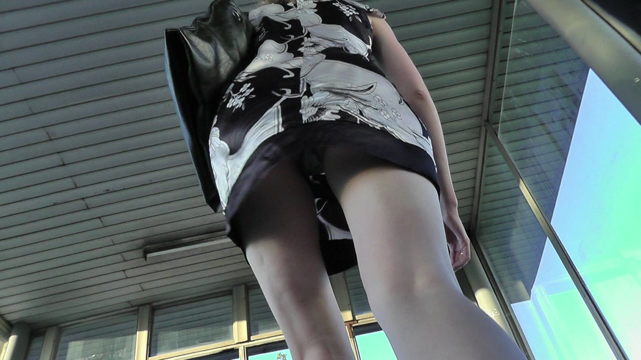Upskirt view of one cute amateur chick going up the stairs