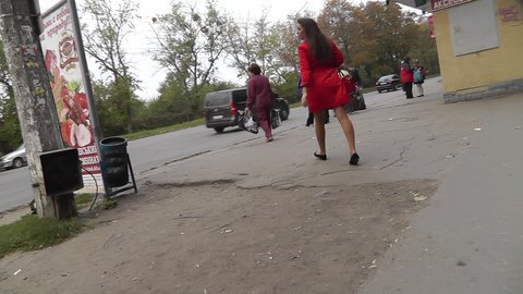 Upskirt free vid of woman in red dress