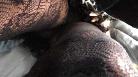 Teen ass wrapped in fishnet up the skirt